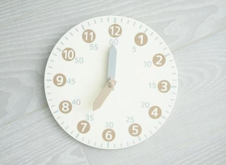 Toy analog clock 7 o'clock