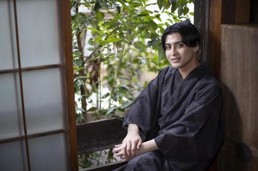 Yukata man smiling by the window
