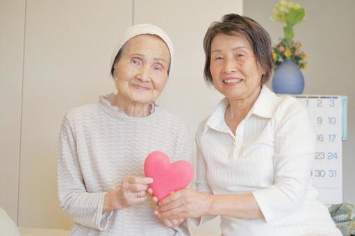 Elderly care Senior mother daughter with heart