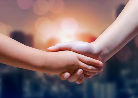 Parent-child handshake and dawn scenery