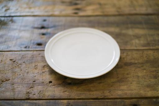 White plate on wood desk
