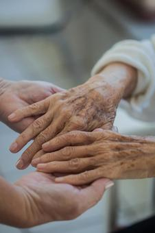 Elderly hands and supporting hands 2