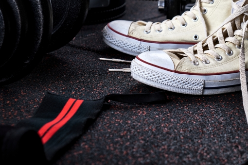 Sneakers on a rubber mat