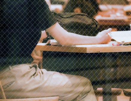 A person studying at a cafe