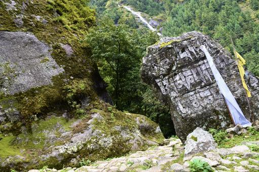 Mani stones and waterfalls between Monjo and Josare in Nepal