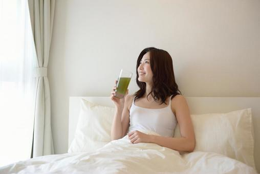 Female drinking a drink in bed 12