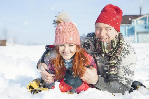 Couple lying on the snow 2