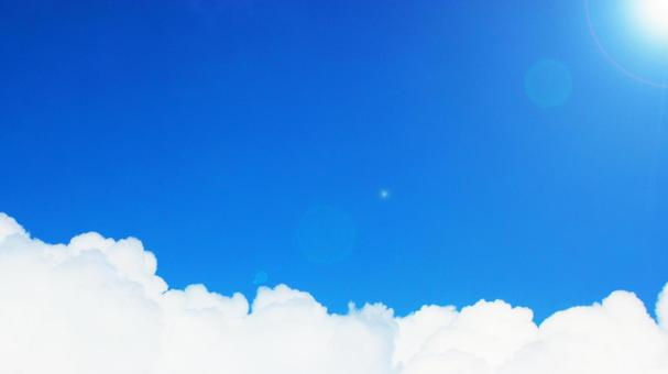 Summer blue sky, bright light of the sun and entrance clouds