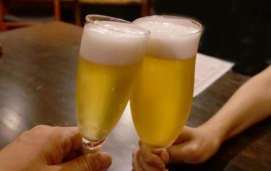 Cheers with a glass beer!