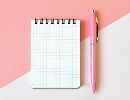 Pink notebook and pen image