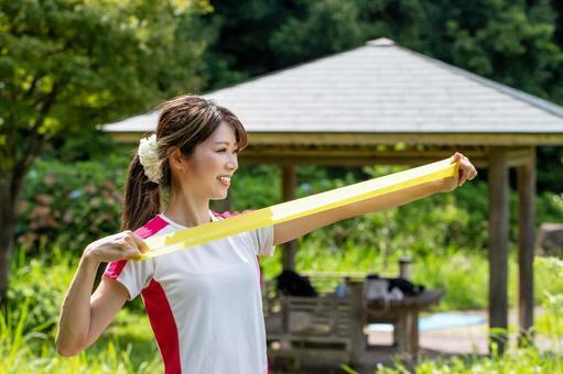 Smile woman doing tube training