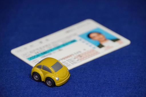 Driver's license yellow minicar blue back
