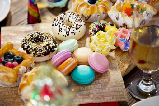 Colorful sweets (macaroons, donut)