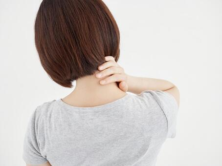 A woman holding her neck aching on a white background