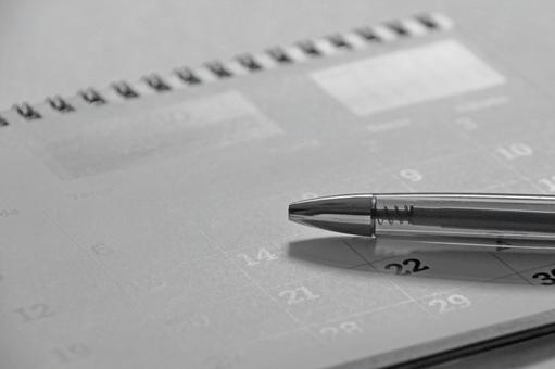 Calendar and pen Business image