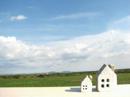 House 2 under blue sky