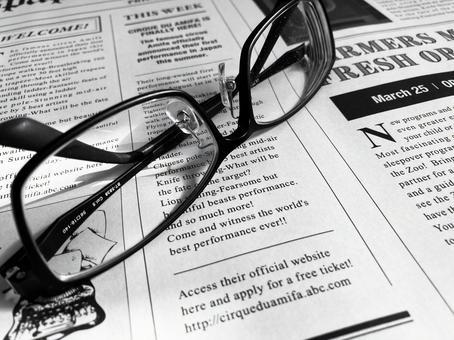 English newspaper and glasses monochrome