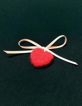 Heart-shaped ornament with ribbon