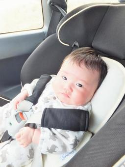 Baby sitting on a child seat