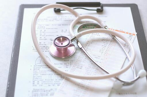 Medical record and stethoscope