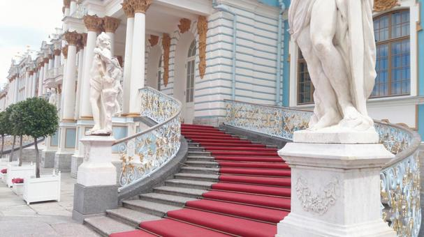 Spiral staircase and red carpet