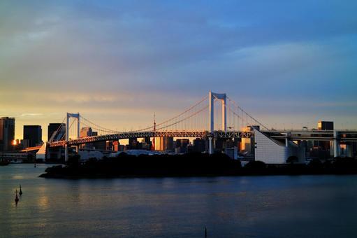 Rainbow bridge that shines in the setting sun