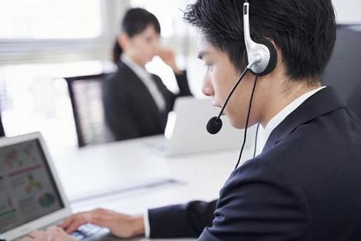 Japanese male businessman having an online meeting in the office
