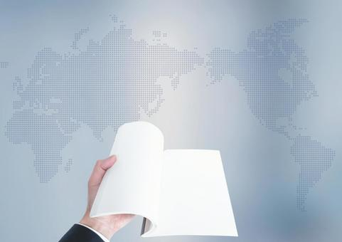 Notebooks and world maps opened by businessmen
