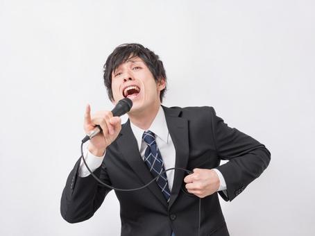 A businessman singing enthusiastically at karaoke