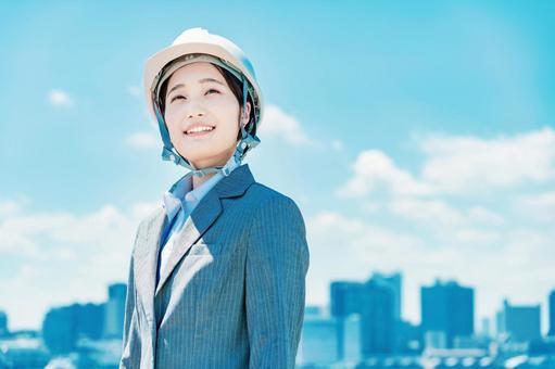 Business woman in a helmet
