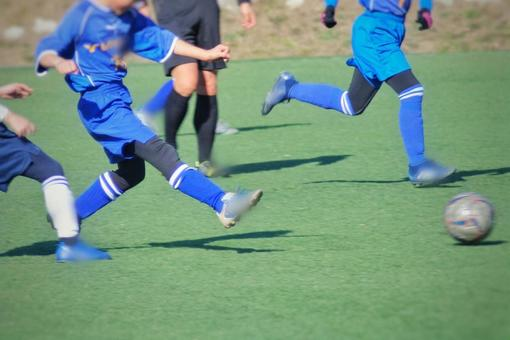Boy playing soccer match