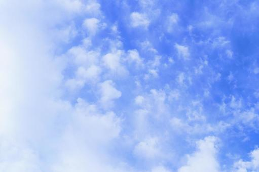 Beautiful sky image with clouds floating thinly in the blue sky