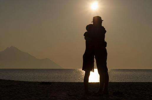 Embracing couple's silhouette 1