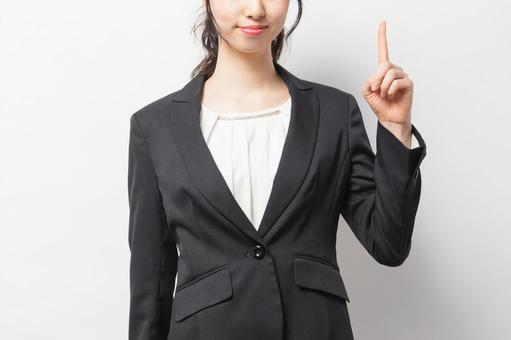 Woman in a suit showing points