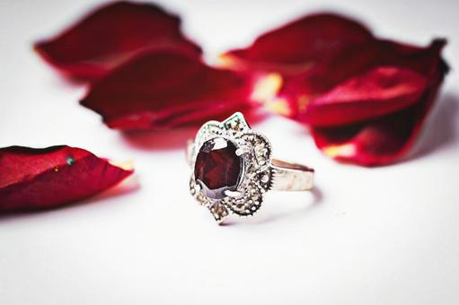 Petals and red stone rings