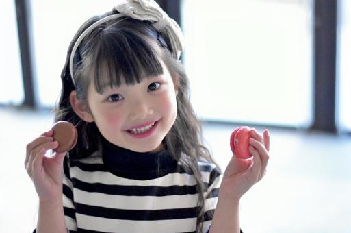 Child with Macaron