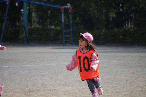 A girl running well in the schoolyard