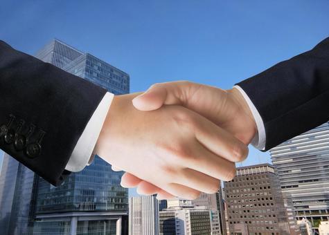 Businessman shaking hands - cityscape background