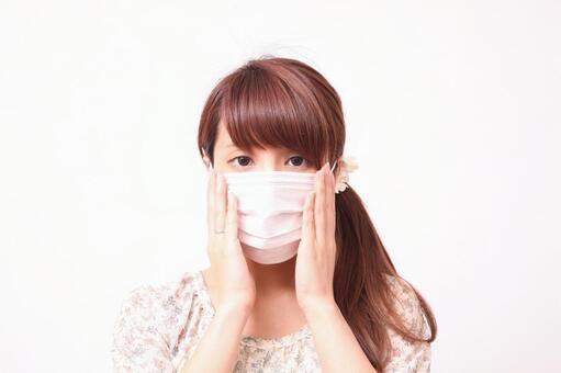 Woman wearing a mask 1