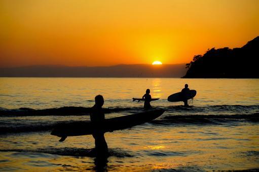 Kamakura coast at dusk and silhouette of surfers