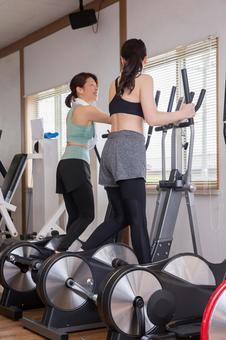 Woman walking in sports gym