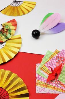 Folding fan, feathers and crane