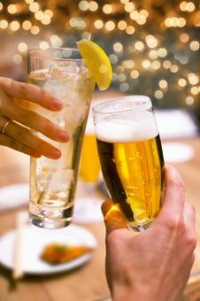 A toast with fancy glass highball and beer