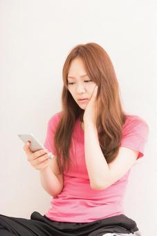 Female using a smartphone 4