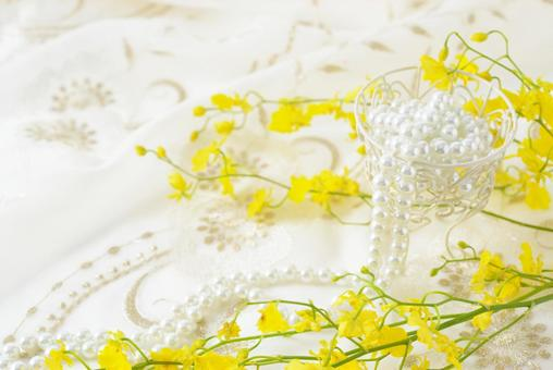 Oncidium flower and pearl necklace