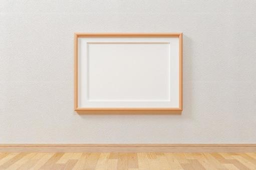 Wooden vertical A4 and A3 size picture frames. White wall. Flooring.