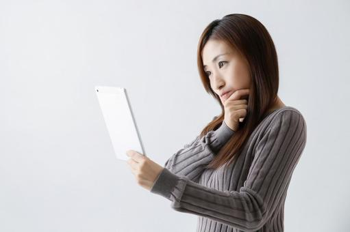 A woman watching a tablet