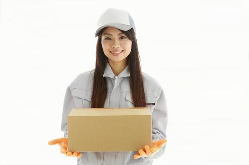 A young woman in work wearing shape to deliver luggage 1