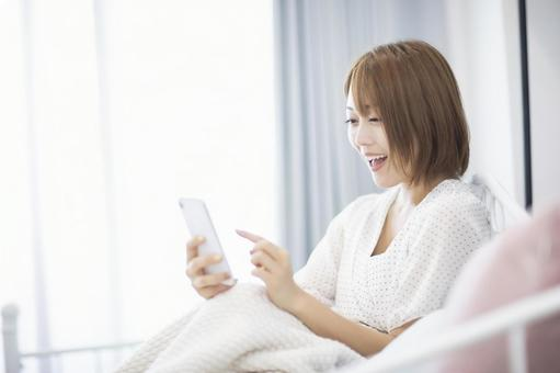 A woman who is pleased to see her smartphone