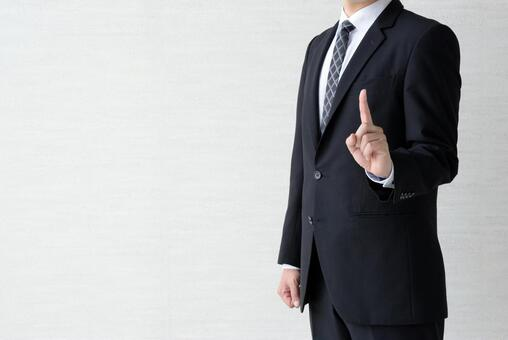 A businessman who raises his index finger